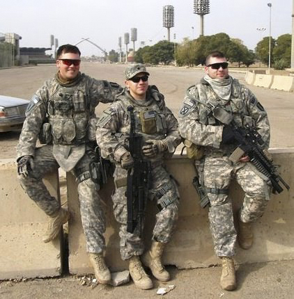 Army Reserve Spc. David Aston (center) returned home from Iraq with the 94th Military Police Company, trained in Saco, in 2011. In the photo with Aston are fellow reservists from southern Maine, Branden Winkel (left) and Ben Johnson.