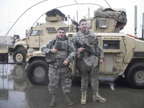Army Reserve Spc. David Aston (left) returned home from Iraq with the 94th Military Police Company, based in Saco, in 2011. At right is fellow reservist Ryan Campbell. The unit spent 10 months training Iraqi police.