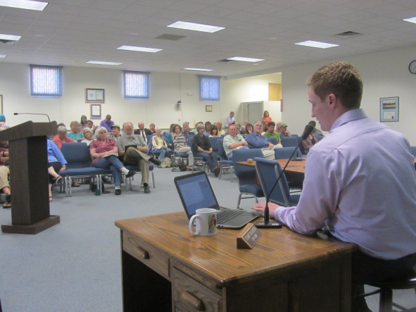 Evan Coleman of Energy Management Inc. answered questions for more than two hours Tuesday night in Rockland about a proposed natural gas fired power plant.