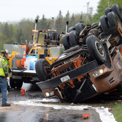 Dump truck rolls in Eddington after collision