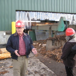 Jim Robbins leads a tour of Robbins Lumber.