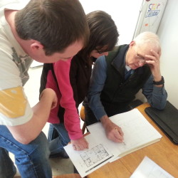 Shawn and Amanda Umble discuss their house plan with Habitat volunteer Lin Lufkin.