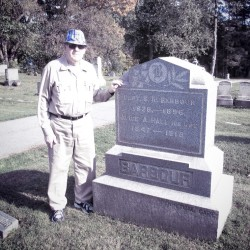 Henry Wiswell at his great grandparents' stone at Oak Hill Cemetery in Brewer