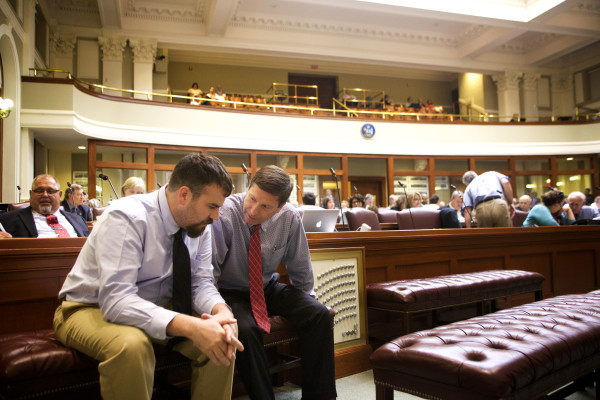 House Majority Leader Jeff McCabe, D-Skowhegan (left) and House Minority Leader Ken Fredette, R-Newport, talk before the House passed a two-year budget early Wednesday morning in Augusta.