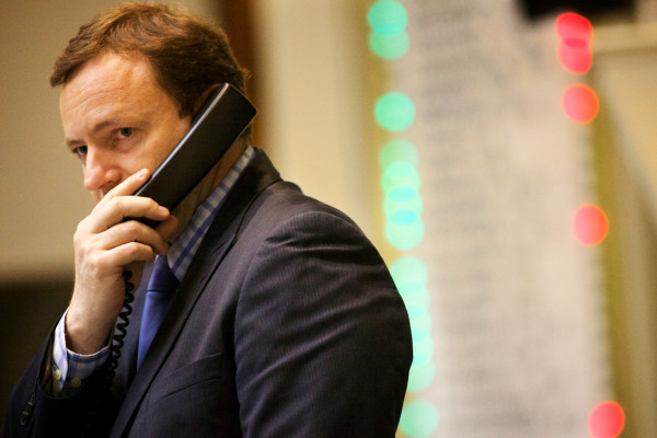 Speaker of the House Mark Eves, D-North Berwick, speaks on the phone as the House votes on a two-year budget.