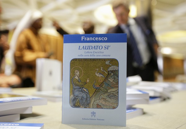 Pope Francis's new encyclical titled &quotLaudato Si (Be Praised), On the Care of Our Common Home&quot, is displayed during the presentation news conference at the Vatican June 18, 2015.