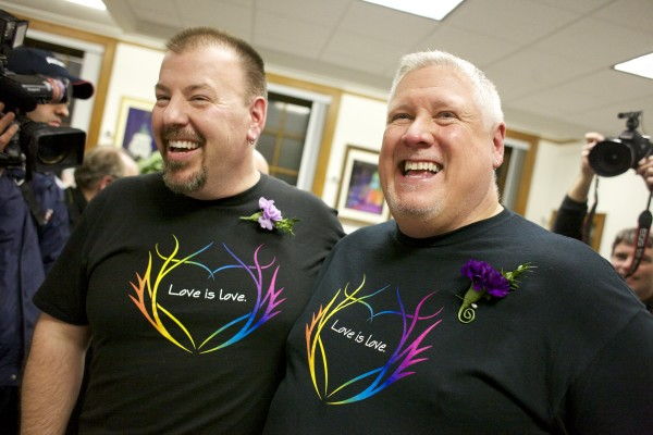 Steven Bridges and Michael Snell smile after getting married at Portland City Hall on Dec. 29, 2012, the first day same-sex couples could obtain marriage licenses.