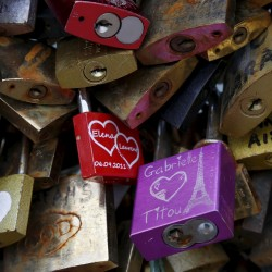 "A close-up picture shows ""love locks"" that are attached to an iron grill on the Pont de Arts over the River Seine in Paris, France, in this May 31, 2015, file photo."