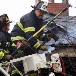 Firefighters work to douse the remaining pockets of flames at the scene of a fatal fire in Portland in this Nov. 1, 2014 file photo.