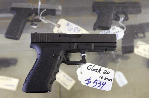 A Glock 20 10mm hand gun is displayed at the sales counter of the Guns-R-Us gun shop in Phoenix, Arizona in this file photo taken December 20, 2012.