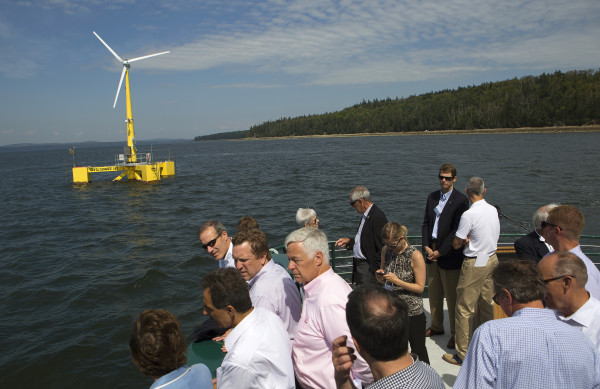 Passengers look at the University of Maine's floating wind turbine, VolturnUS, in September 2014 in Castine during a trip to celebrate its first year. The 1:8-scale prototype for the huge 6-megawatt turbines is the first grid-connected offshore floating wind turbine in the US.
