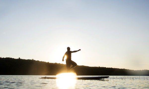 Brian Ulbrich of Southwest Harbor does a yoga pose during an Acadia Stand Up Paddle Boarding yoga class at Echo Lake on Mount Desert Island.