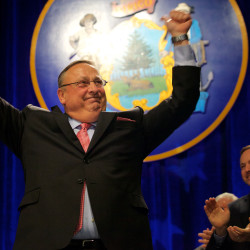 Gov. Paul LePage celebrates while taking the stage at his second inaugural in Augusta on Jan. 7. Speaker of the House Mark Eves applauds.