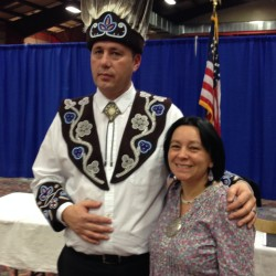 Jennifer Sapiel Neptune (right) poses with Penobscot Chief Kirk Francis at his inauguration ceremony in 2014.  Jennifer created the headdress, collar and cuffs by hand, a reproduction of Penobscot artifacts from 1870 that are part of the collection at Orono's Hudson Museum.