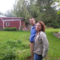 Chris and Jill Packard, on their backyard farm in Hampden.
