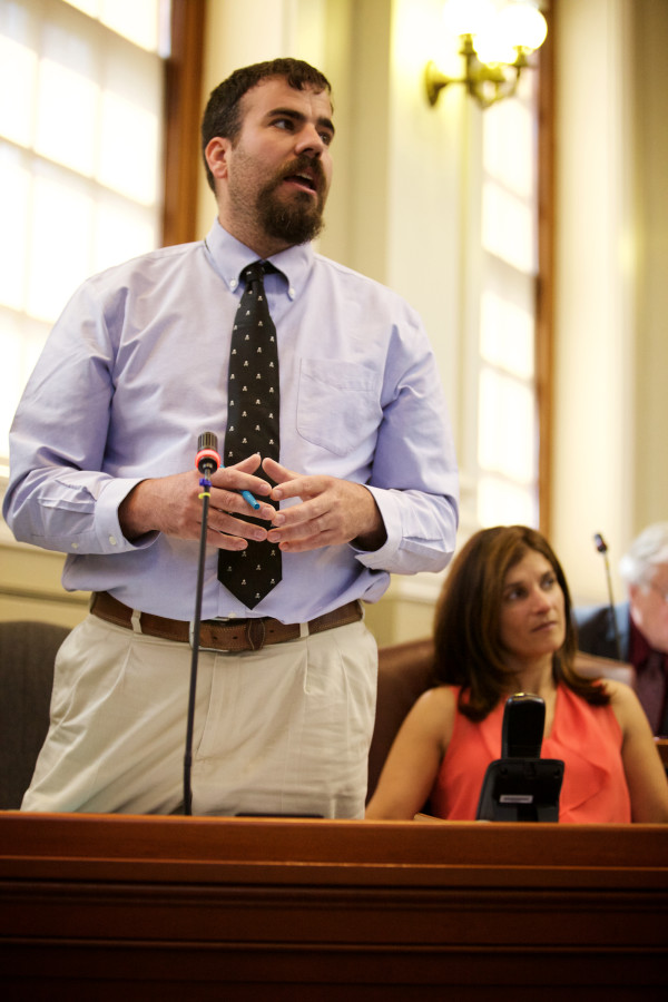 Democratic Majority Leader Jeff McCabe (left) and Rep. Sara Gideon work to override Gov. Paul LePage's budget veto Tuesday morning in Augusta.