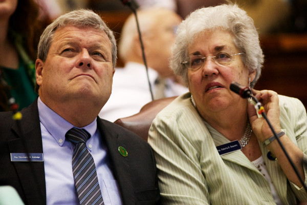 Rep. Christopher Babidge (left), D-Kennebunk, and Roberta Beavers, D-South Berwick, watch the vote tally come in as the House overrides Gov. Paul LePage's budget veto Tuesday in Augusta.