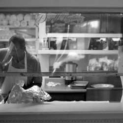 A volunteer prepares lunch at the Bangor Area Homeless Shelter in this September 2013 file photo.