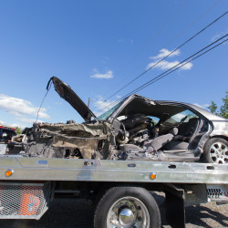 Chelsea woman sent to hospital after car collides with crane