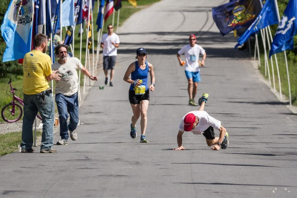 Michael Westphal falls to the pavement near the finish line of the The Great Run marathon on Saturday on the island.