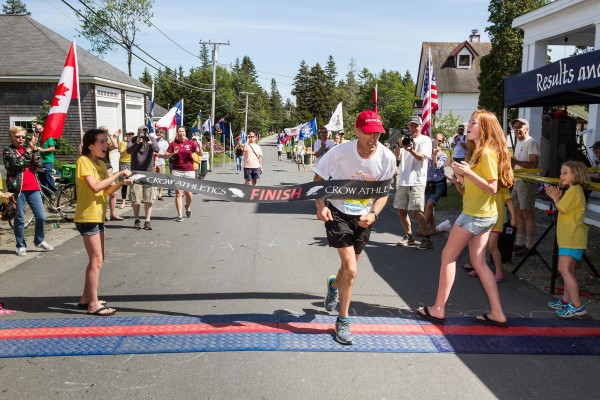 Michael Westphal is cheered on by fans and race workers on Saturday as he completes The Great Run marathon on the island.
