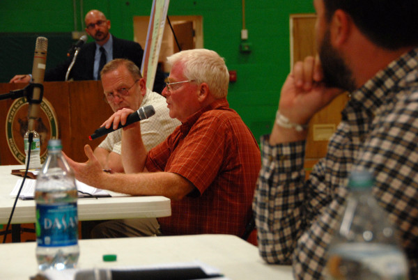 Maine Forest Products Council Executive Director Patrick Strauch, holding the microphone, discusses the proposed North Woods national park during a debate at Schenck High School in East Millinocket Thursday, June 18.