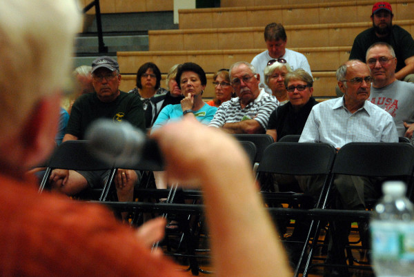 Katahdin region residents listen to supporters and critics discuss the North Woods national park during a debate at Schenk High School in East Millinocket Thursday, June 18.