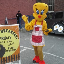 Judy Commeau donned a chicken suit to draw people in to the Hammond Street Senior Center's big breakfast Friday, June 12.