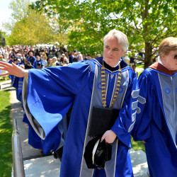 Colby College President David Greene, left, and actor/filmmaker Robert Redford march out with the graduating seniors at the school's commencement on Sunday, May, 24, 2015.