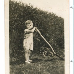 Margie Spencer-Smith as a child in England, already trying to use a spade.