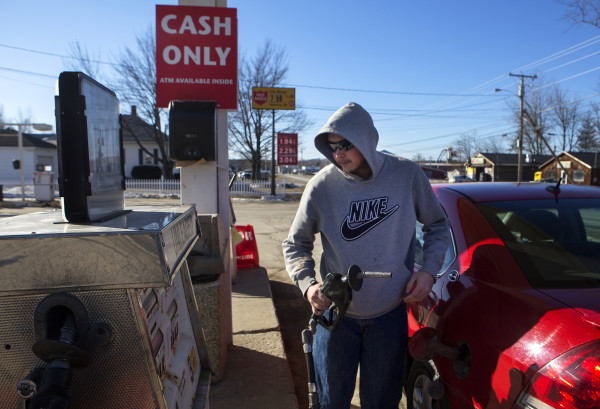 Gavin Dunphy fills his tank up at C.N. Brown's gas station in Pittsfield on Jan. 20.