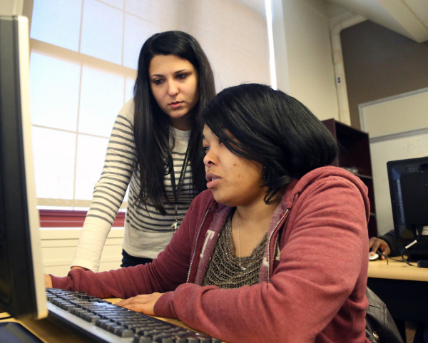 Dima Walters helps Elizabeth Abrams during GED classes at the West Campus-Adult Education Center  on Jan. 13, 2015 in Detroit, Michigan.