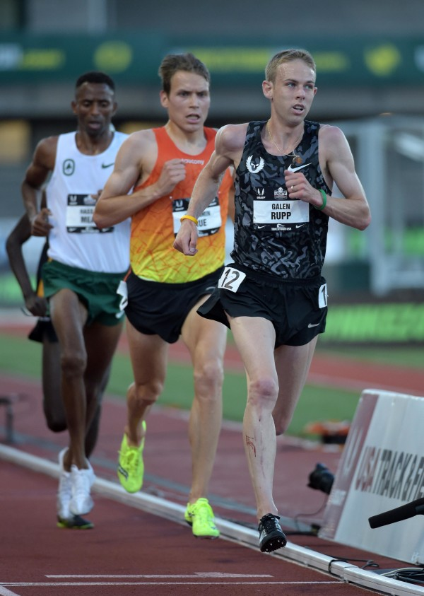 Galen Rupp defeats Ben True (center) to win the 10,000 meters in 28:11.61 in the 2015 USA Championships at  Hayward Field.