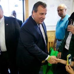New Jersey Gov. Chris Christie shakes hands at Becky's Diner in Portland on Wednesday morning with Maine Gov. Paul LePage in tow. Later, LePage endorsed Christie for the Republican presidential nomination.