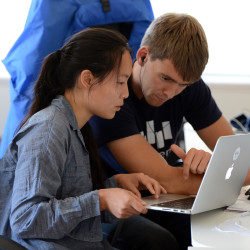 Transcense COO and cofounder Pieter Doevendas, right, works with intern Lutetia Li at the company's office in Oakland, California, on July 27, 2015.