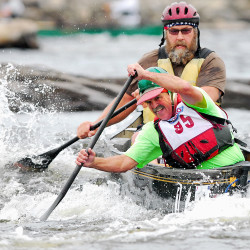 Paul Brown of Swanville (front) and Rick O'Donald of Newburgh navigate through some whitewater during the final day of the Penobscot River Whitewater Nationals Regatta on Sunday.
