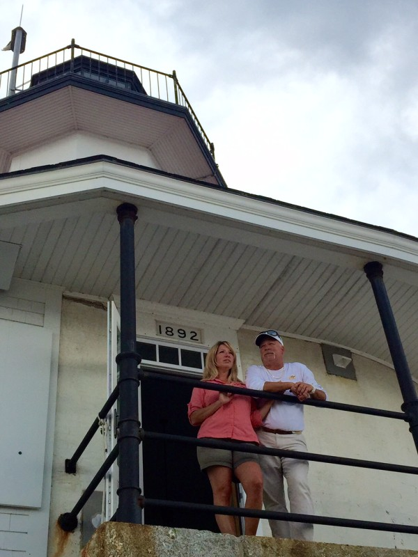Lighthouse keepers Heather Graham and Mark Zinkiewicz check the weather from the lighthouse deck. &quotWe are living our lives by the tides, for boat and guest safety,&quot he said.