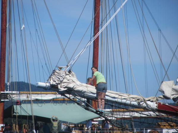 Ellery Chalmers is doing some final work before the schooner Lewis R. French sets sail in the 2015 Great Schooner Race on Friday in Islesboro.