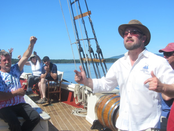 Capt. Noah Barnes (right) of the schooner Stephen Taber gives a pep talk to the crew and passengers before the start of the 2015 Great Schooner Race on Friday in Islesboro.