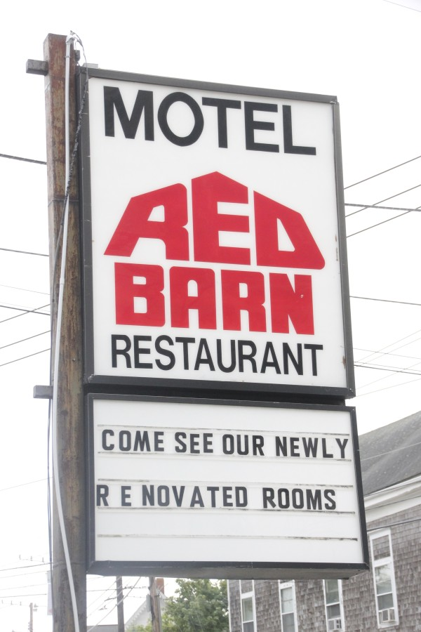 The Red Barn Hotel sign advertises newly renovated rooms. The hotel had closed 16 rooms for renovation when fire broke out in January 2014. The rooms reopened at the end of June.
