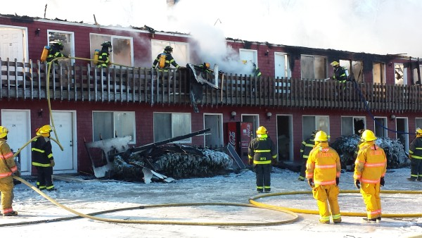 About two dozen firefighters from Milbridge and neighboring communities battle a fire at the Red Barn Motel in this Jan. 24, 2014, file photo.