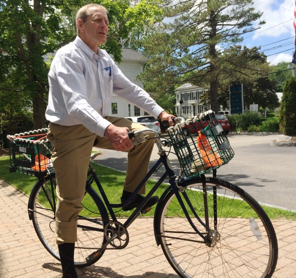 Jim Huebener talks about how he came up with the idea to create bike baskets out of Maine lobster traps on Thursday in Cape Elizabeth.