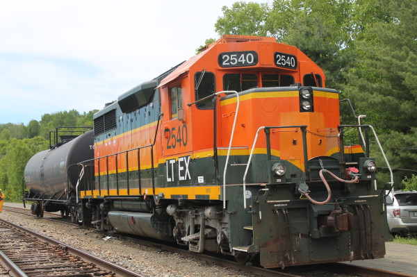 A Central Maine and Quebec Railway locomotive and tank car are used in a training exercise in Greenville Junction recently.