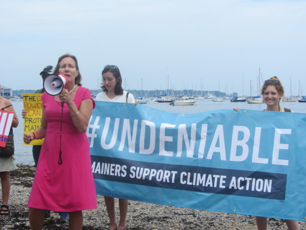 Beth Ahearn (left), policy director of the Maine Conservation Alliance, spoke to 70 people who gathered Thursday at Sandy Beach in Rockland. The people called for support for the expected release next week of a national Clean Power Plan by the Environmental Protection Agency.