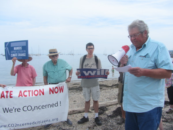 Richard Nelson (right), a fisherman from Friendship and a member of the Ocean Acidification Commission, voiced support for a plan to be released by the Environmental Protection Agency to regulate power plant emissions on Thursday at Sandy Beach in Rockland.