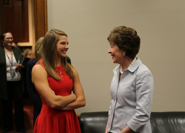 Kate Hall of Casco (left) chats with Sen. Susan Collins on Wednesday in Washington, D.C. Hall, a star track and field performer, testified before the Senate Special Committee on Aging at a hearing about diabetes issues and research. Collins chairs the committee.