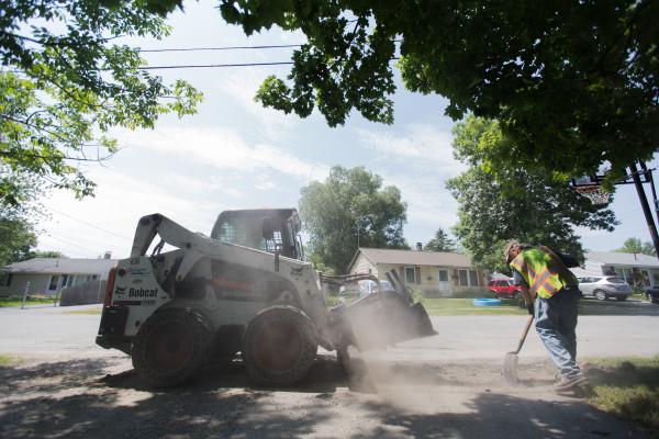 Mark Turner shovels gravel during construction work on Jowett Street in Bangor on Tuesday, July 14.