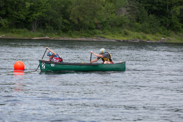 Ashton (left) and JR Mabee (right) cross the finish line at the  Penobscot River Whitewater Nationals Regatta on Thursday morning.