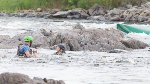 Ryan Linehan reaches out for his son after capsizing at the Penobscot River Whitewater Nationals Regatta Thursday morning.