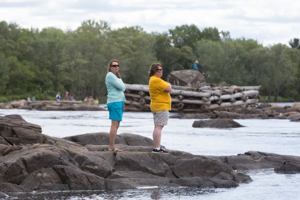 Laura Lefreniere (left) and Eileen Boothby (right) spectate the Penobscot River Whitewater Nationals Regatta on Thursday to cheer on Boothby's brother, Carl Lefreniere.